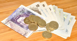 English Bank Notes And Coins Stock Photo
