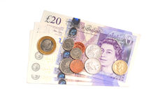 English banknotes and coins. Photograph showing English bank notes and coins isolated Royalty Free Stock Photo