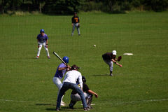 English baseball. A baseball game in England taken from behind the net Royalty Free Stock Image