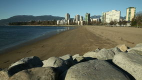 English Bay Beach Winter, Vancouver. A quiet English Bay beach on a sunny, winter day with just the seagulls. British Columbia, Canada stock video