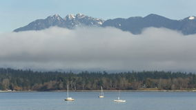 English Bay Fog and Peaks stock video footage