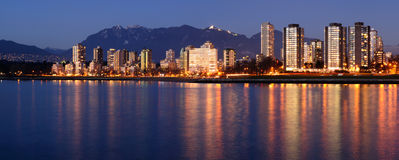 English Bay highrises at dusk Stock Photography