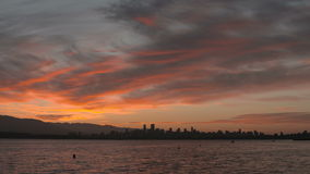 English Bay Sunrise Pan, Vancouver. A pan of English Bay and the apartment buildings and condominiums of Vancouver's West End neighbourhood at dawn stock footage