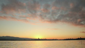 English Bay, Vancouver Cityscape Dawn. Downtown Vancouver at dawn from the south side of English Bay. British Columbia, Canada stock video footage