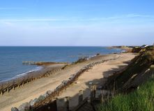 English Beach. Happisburgh Beach on the Norfolk Coast in the UK on an early summer's day Royalty Free Stock Photos