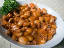 English beans with bacon. Traditional English dish: beans, bacon, tomato sauce Stock Images