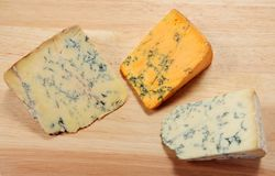 English blue cheeses on a board Stock Photography