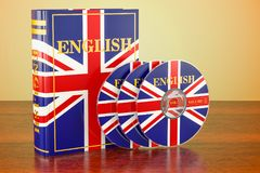 English book with flag of UK and CD discs on the wooden table. 3. D Stock Photo