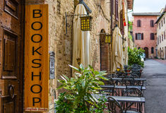 English bookshop banner. English bookshop in Tuscany near a restaurant along a nice alley Royalty Free Stock Image