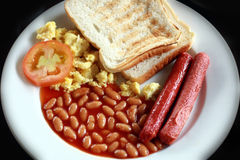 English breakfast. With scrambled eggs, toast, sausage, beans, tomato stock photography