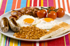English Breakfast. Served on white plate stock images