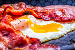 English breakfast. Bacon and eg on frying pan Royalty Free Stock Image