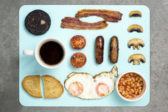 English Breakfast on blue chopping board Royalty Free Stock Image