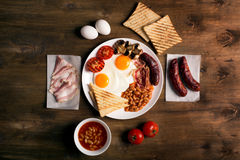 English breakfast on a brown wooden table Royalty Free Stock Image
