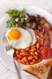 English breakfast close-up on a plate. vertical top view Stock Image