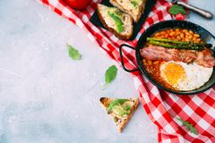 English breakfast concept with avocado toast over blue vintage background. stock photos