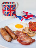 English breakfast  with cup of tea and british flag behind Stock Image