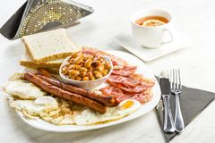 English breakfast only with a cup of tea. A powerful portion of calories will provide energy for the whole day Royalty Free Stock Photos