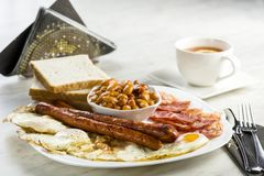English breakfast only with a cup of tea. A powerful portion of calories will provide energy for the whole day Royalty Free Stock Photo
