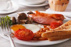 English breakfast: eggs, sausage, tomato, beans and mushrooms Stock Images