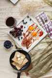 English breakfast - fried egg, bacon, bread blueberryand cherry Royalty Free Stock Image