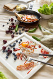 English breakfast - fried egg, bacon, bread blueberryand cherry Royalty Free Stock Images