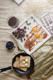 English breakfast - fried egg, bacon, bread blueberryand cherry Stock Photos