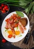 English breakfast - fried egg, sausage, tomatoes, bacon Stock Photo