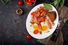 English breakfast - fried egg, sausage, tomatoes, bacon Royalty Free Stock Photography