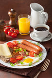 English breakfast with fried egg sausages bacon tomatoes beans Stock Photography