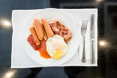 English breakfast with fried eggs, bacon, sausages, Royalty Free Stock Images
