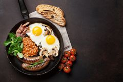 English breakfast. Fried eggs, sausages, bacon Royalty Free Stock Photo