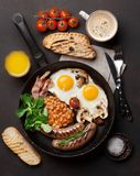 English breakfast. Fried eggs, sausages, bacon Stock Photography