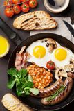 English breakfast. Fried eggs, sausages, bacon Royalty Free Stock Photography