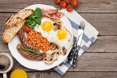 English breakfast. Fried eggs, sausages, bacon Royalty Free Stock Photos