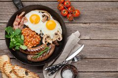 English breakfast. Fried eggs, sausages, bacon Royalty Free Stock Image