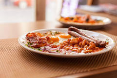 English Breakfast:fried eggs, sausages, beans Stock Images