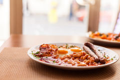 English Breakfast:fried eggs, sausages, beans Royalty Free Stock Image