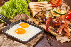 English breakfast with fried eggs, sausages and vegetable Stock Photo