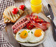 English Breakfast with  fried eggs, toasts, orange juice and cof Royalty Free Stock Images