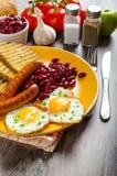 English breakfast - garlic toast, fried egg, beans and English breakfast, toast, egg, beans, sausages Royalty Free Stock Photo
