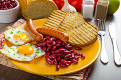 English breakfast - garlic toast, fried egg, beans and English breakfast, toast, egg, beans, sausages Stock Photo
