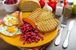 English breakfast - garlic toast, fried egg, beans and English breakfast, toast, egg, beans, sausages Stock Photography