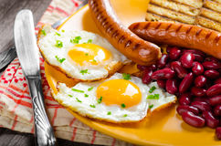 English breakfast - garlic toast, fried egg, beans and English breakfast, toast, egg, beans, sausages Stock Image