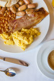 English breakfast on a plate with bread, orange juice and and co Royalty Free Stock Images