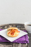 English breakfast. Salt muffin with scrambled eggs, bacon and ch Stock Image
