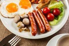 English breakfast with sausage Stock Photos