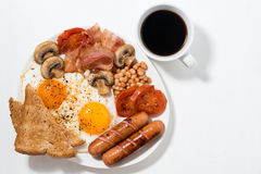 English breakfast of scrambled eggs with bacon, sausages Stock Photos