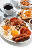 English breakfast of scrambled eggs with bacon, sausages Royalty Free Stock Images