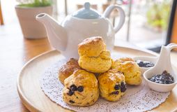 English breakfast and tea break. scones on wooden table with a cup of tea. English breakfast and tea break, scones on wooden table with a cup of tea royalty free stock images